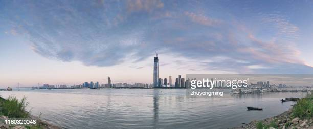 wuhan urban skyline panoramic,yangtze river - wuhan stock photos and pictures