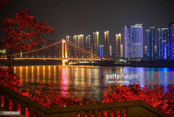 Wuhan Yangtze River Bridge at night, Wuhan City, Hubei Province, China, March 25, 2020. With the continuous improvement of the epidemic situation,...