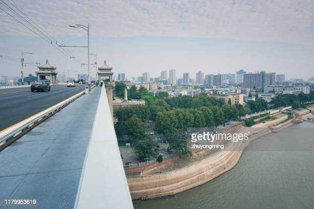 wuhan yangtze river cityscape - wuhan stock photos and pictures