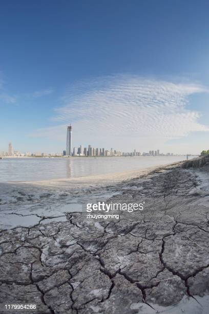 wuhan yangtze river cityscape,drought land - wuhan stock photos and pictures