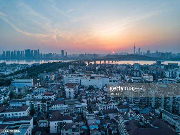 wuhan yellow crane tower sunset - wuhan stock photos and pictures