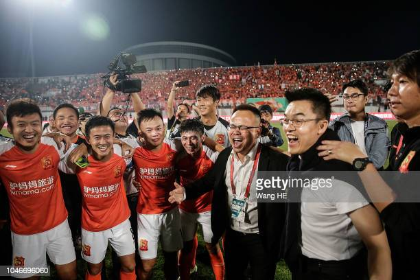 Wuhan Zall coach Li Tie and player celebration upgrade to next season of China Football Association Super League after 2018 Chinese League match...