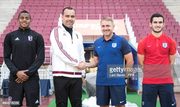 Wuilker Farinez of Venezuela head coach Rafael Dudamel of Venezuela head coach Paul Simpson of England and Lewis Cook of England pose for a picture...