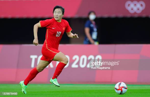 Wurigumula of Team China runs with the ball during the Women's First Round Group F match between China and Brazil during the Tokyo 2020 Olympic Games...
