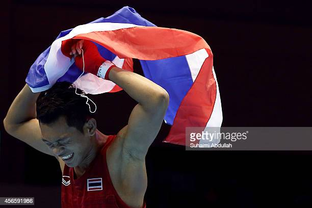 Wuttichai Masuk of Thailand celebrates victory over Lim Hyunchul of South Korea during the men's boxing light welter weight bout final on day...