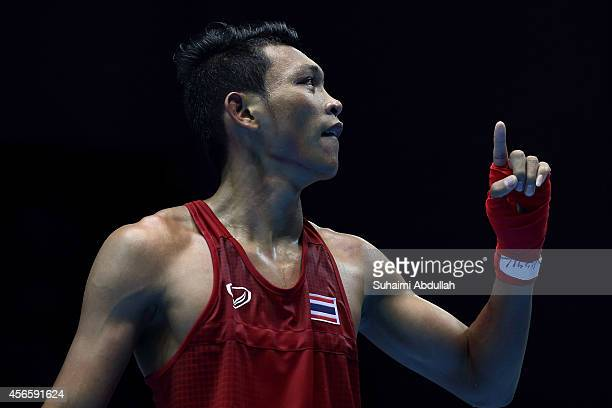 Wuttichai Masuk of Thailand reacts at the end of his fight with Lim Hyunchul of South Korea during the men's boxing light welter weight bout final on...