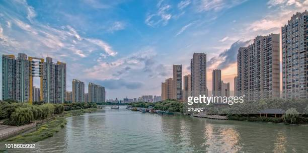 wuxi city central building in dusk - jiangsu province stock pictures, royalty-free photos & images