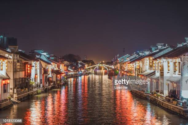 wuxi grand canal night view - liyao xie stock pictures, royalty-free photos & images