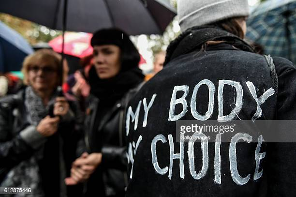 Wwoman with an inscription on her jacket 'My body my choice' participates in the Black Monday a nationwide women's proabortion protest on October 03...