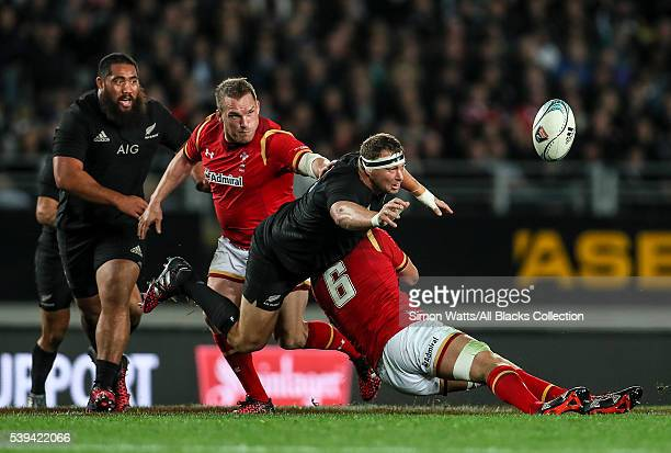 Wyatt Crocket of the All Blacks offloads the ball during the International Test match between the New Zealand All Blacks and Wales at Eden Park on...
