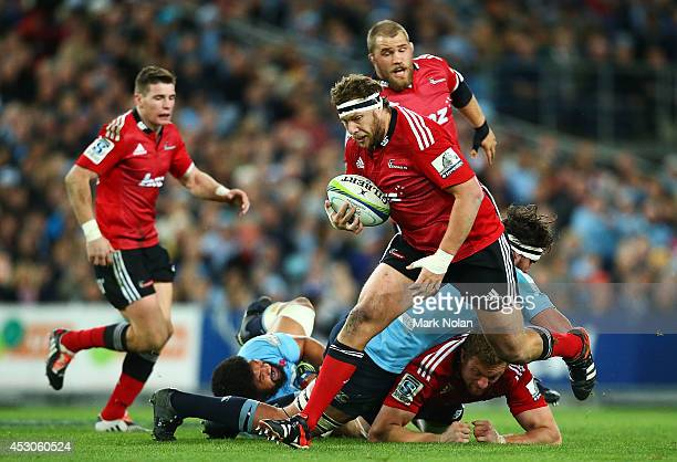 Wyatt Crocket of the Crusaders runs the ball during the Super Rugby Grand Final match between the Waratahs and the Crusaders at ANZ Stadium on August...