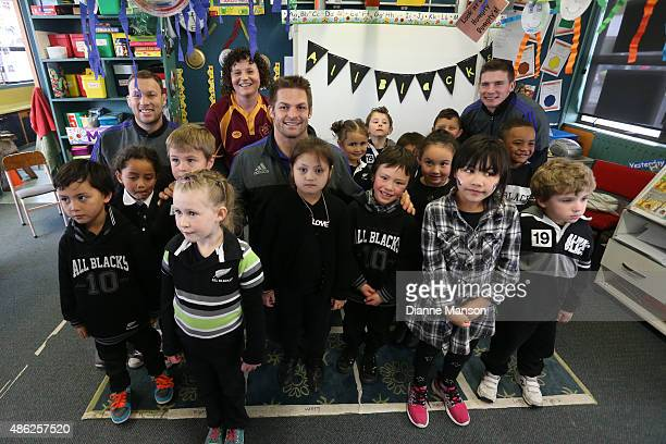 Wyatt Crocket Richie McCaw and Colin Slade of the New Zealand All Blacks pose for a photo during the All Black To The Nation visit to Mataura school...
