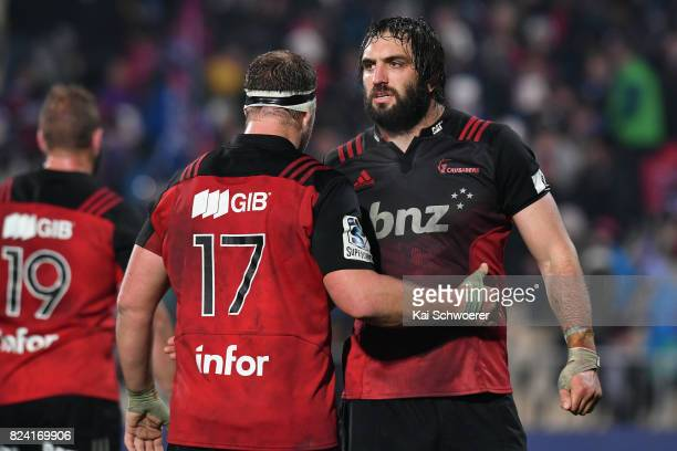 Wyatt Crockett and Samuel Whitelock of the Crusaders celebrate their win in the Super Rugby Semi Final match between the Crusaders and the Chiefs at...