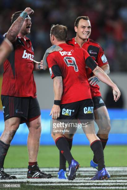Wyatt Crockett Andy Ellis and Israel Dagg celebrate their win during the round one Super Rugby match between the Blues and the Crusaders at Eden Park...