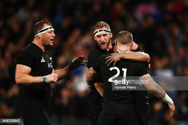 Wyatt Crockett Kieran Read and TJ Perenara of the All Blacks celebrate after Lima Sopoaga's try during the Rugby Championship match between the New...