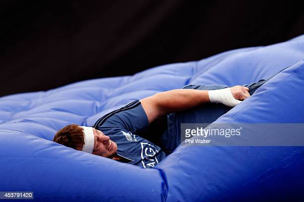 Wyatt Crockett of the All Blacks lands in the tackle matress during a New Zealand All Blacks training session at Trusts Stadium on August 19 2014 in...