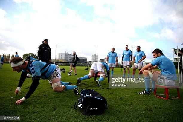 Wyatt Crockett of the All Blacks practices his scrum technique during a New Zealand All Blacks training session at Latymers Upper School on November...