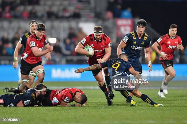 Wyatt Crockett of the Crusaders charges forward during the round 18 Super Rugby match between the Crusaders and the Highlanders at AMI Stadium on...