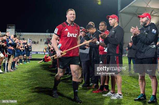 Wyatt Crockett of the Crusaders is congratulated after his 200th Super Rugby match during the round 18 Super Rugby match between the Crusaders and...
