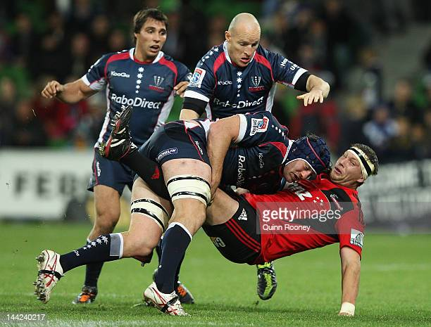 Wyatt Crockett of the Crusaders is tackled by Cadeyrn Neville of the Rebels during the round 12 Super Rugby match between the Rebels and the...