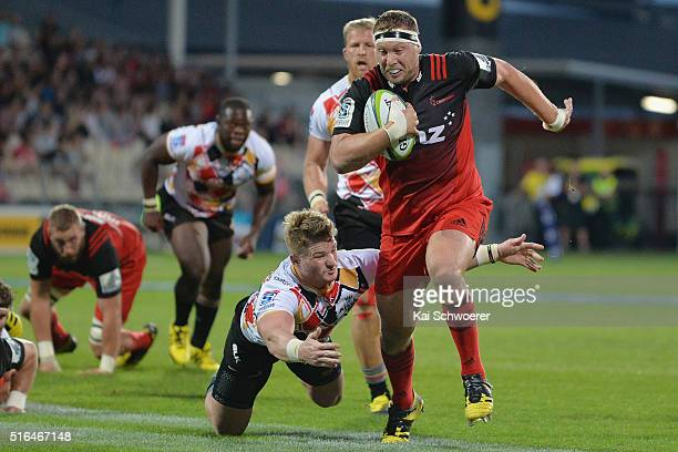 Wyatt Crockett of the Crusaders is tackled during the round four Super Rugby match between the Crusaders and the Kings at AMI Stadium on March 19...
