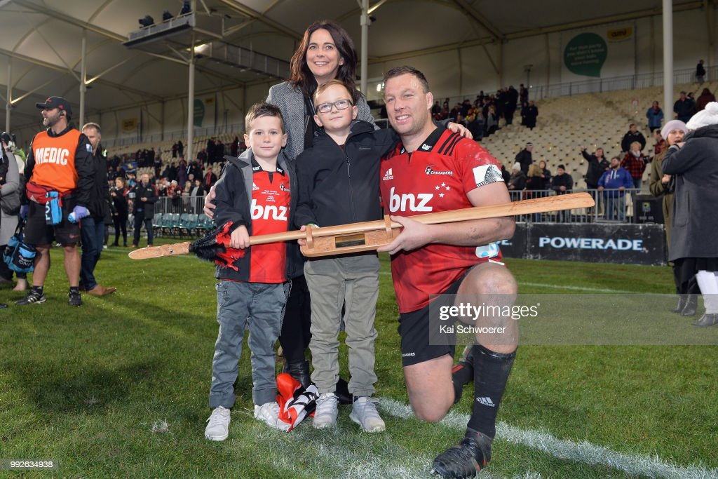 Wyatt Crockett of the Crusaders (R) poses with his wife Jenna and his sons Sonny and Emmett and a taiaha, a traditional Maori weapon, after his 200th Super Rugby match during the round 18 Super Rugby match between the Crusaders and the Highlanders at AMI Stadium on July 6, 2018 in Christchurch, New Zealand.