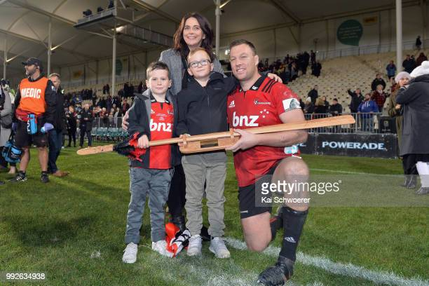 Wyatt Crockett of the Crusaders poses with his wife Jenna and his sons Sonny and Emmett and a taiaha a traditional Maori weapon after his 200th Super...