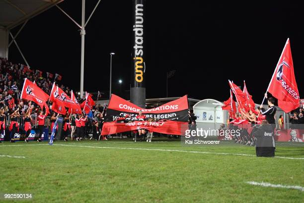 Wyatt Crockett of the Crusaders runs out for his 200th Super Rugby match prior to the round 18 Super Rugby match between the Crusaders and the...