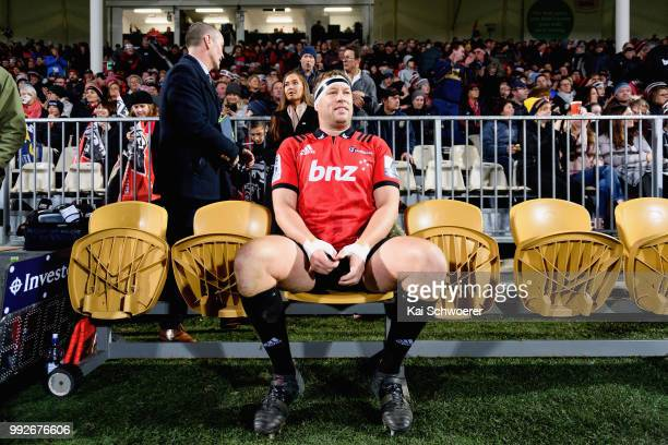 Wyatt Crockett of the Crusaders sits on the bench prior to his 200th Super Rugby match during the round 18 Super Rugby match between the Crusaders...