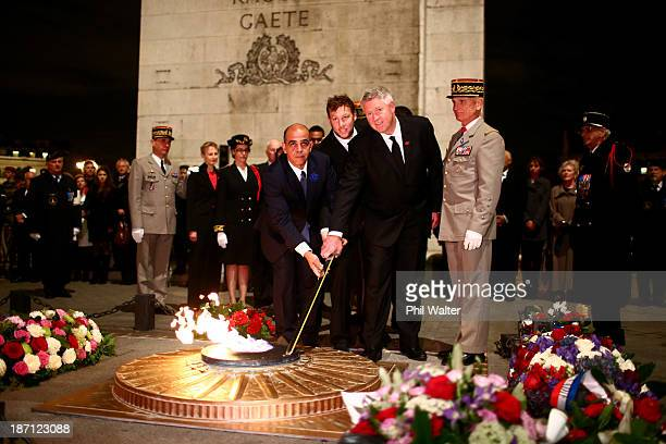 Wyatt Crockett of the New Zealand All Blacks and NZRU CEO Steve Tew rekindle the flame at the Tomb of the Unknown Soldier at the Arc de Triomphe on...