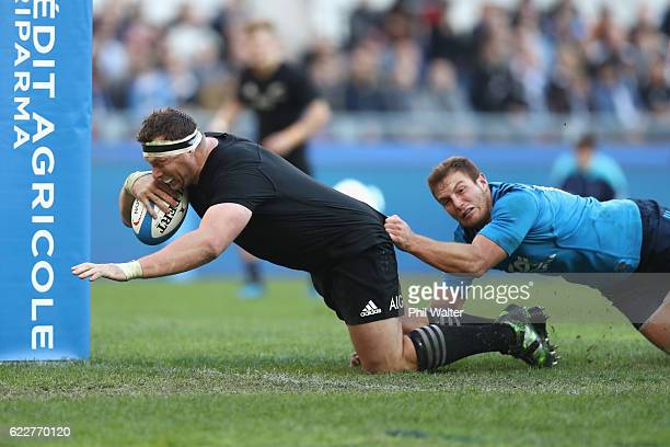 Wyatt Crockett of the New Zealand All Blacks scores a try during the international rugby match between New Zealand and Italy at Stadio Olimpico on...
