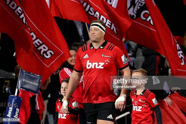 Wyatt Crockett the most capped player in Super Rugby history runs out onto the field with his children for his 200th appearance for the Crusaders...