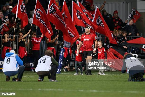 Wyatt Crockett the most capped player in Super Rugby history runs out onto the field for his 200th appearance for the Crusaders ahead of the round 18...
