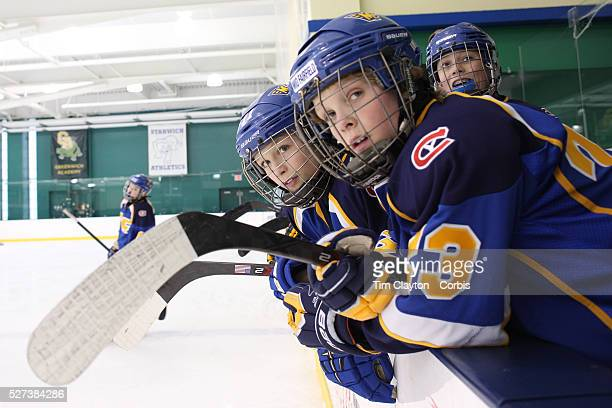 Wyatt Pastor front and team mates watch the action from the bench during the Mid Fairfield Yankees Pee Wee Major Ice Hockey team against the...