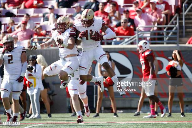 Wyatt Ray of the Boston College Eagles celebrates with Ty Schwab after an interception in the third quarter of a game against the Louisville...