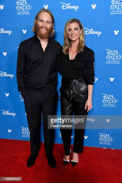 Wyatt Russell Emily VanCamp attend D23 Disney Showcase at Anaheim Convention Center on August 23 2019 in Anaheim California