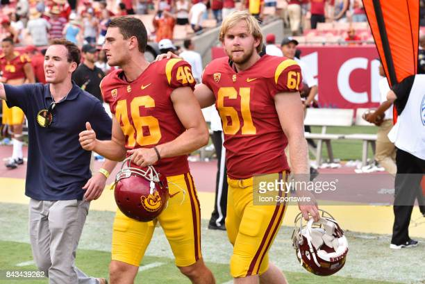 Wyatt Schmidt PHLD leads USC Jake Olson to an interview after a college football game between the Western Michigan Broncos and the USC Trojans on...