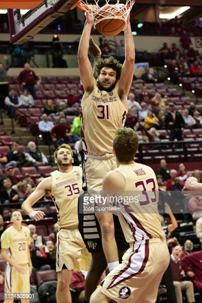 Wyatt Wilkes forward Florida State University Seminoles slams the basketball home for two points off the bench against the Wake Forest Demon Deacons...