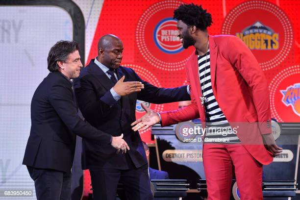 Wyc Grousbeck of the Boston Celtics Magic Johnson of the Los Angeles Lakers and Joel Embiid of the Philadelhpia 76ers stand on stage during the 2017...