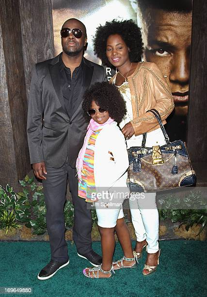 Wyclef Jean and family attend the 'After Earth' premiere at the Ziegfeld Theater on May 29 2013 in New York City