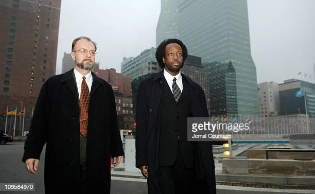 Wyclef Jean and Hugh Locke depart after meeting with UN Secretary General Kofi Annan