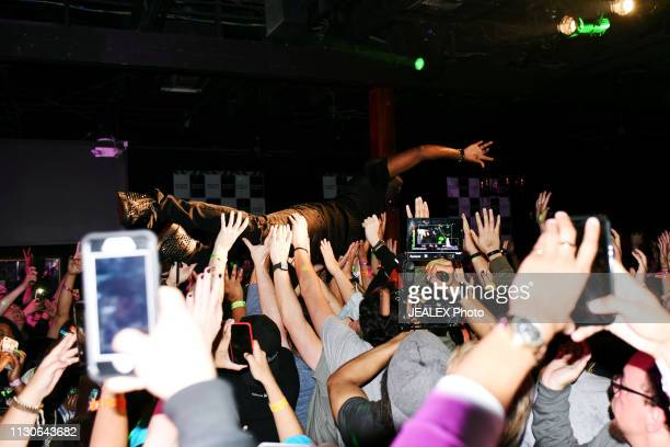 Wyclef Jean crowd surfs at HEADS Music during the 2019 SXSW Conference and Festivals on March 14 2019 in Austin Texas