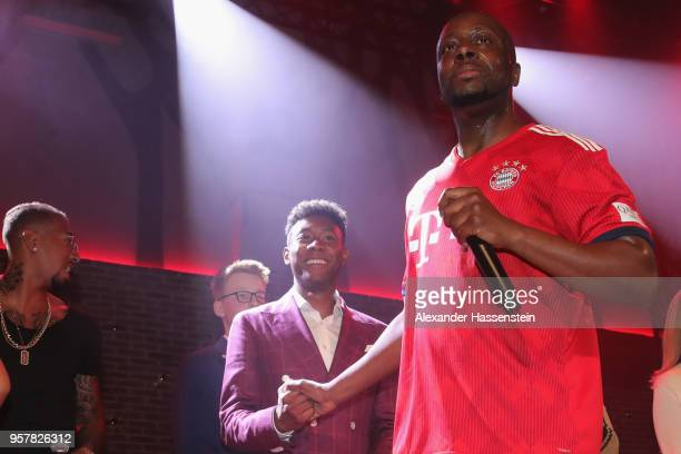 Wyclef Jean performes with Jerome Boateng of FC Bayern Muenchen and his team mate David Alaba at the FC Bayern Muenchen Celebration 2018 Party at...