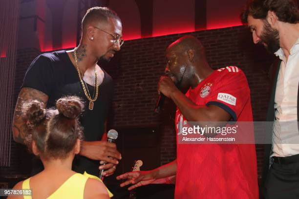 Wyclef Jean performes with Jerome Boateng of FC Bayern Muenchen at the FC Bayern Muenchen Celebration 2018 Party at Nockherberg on May 12 2018 in...