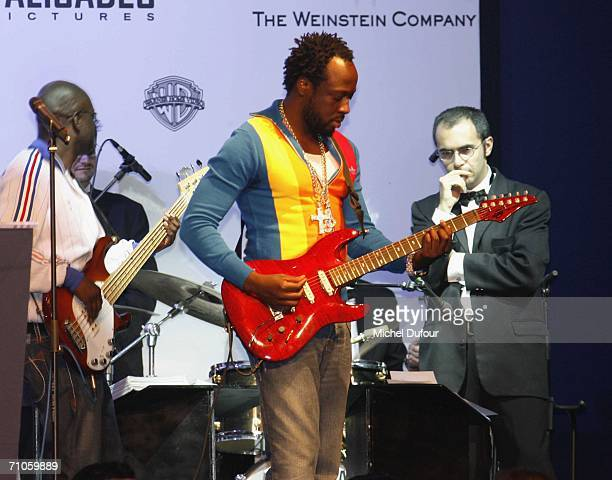 """Wyclef Jean performs at the auction at """"Cinema Against AIDS 2006"""", the annual event in aid of amfAR at Le Moulin de Mougins during the 59th..."""