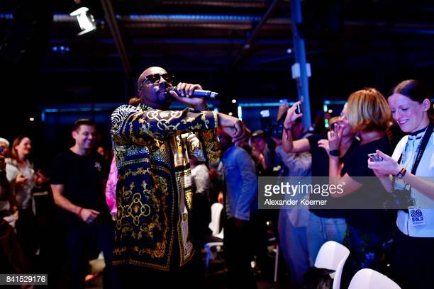 Wyclef Jean performs at the end of the 'The Fall and Rise of a Refugee' panel talk during the Bread & Butter by Zalando at Festsaal Kreuzberg on...