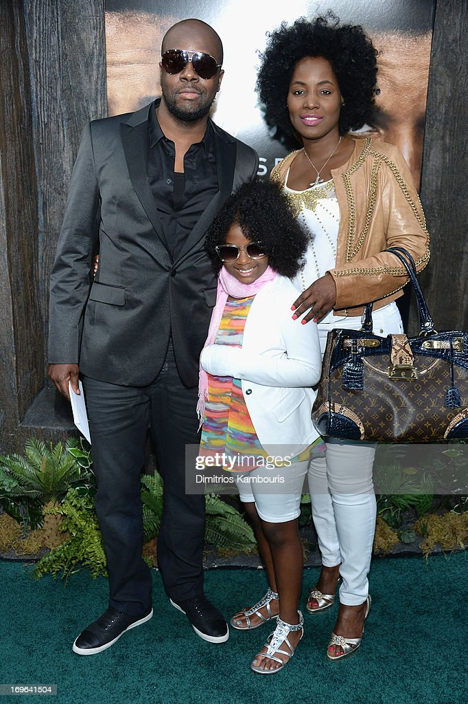 Wyclef Jean, wife Claudenette Jean and daughter Angelina Claudinelle Jean attend the 'After Earth' premiere at the Ziegfeld Theater on May 29, 2013 in New York City.