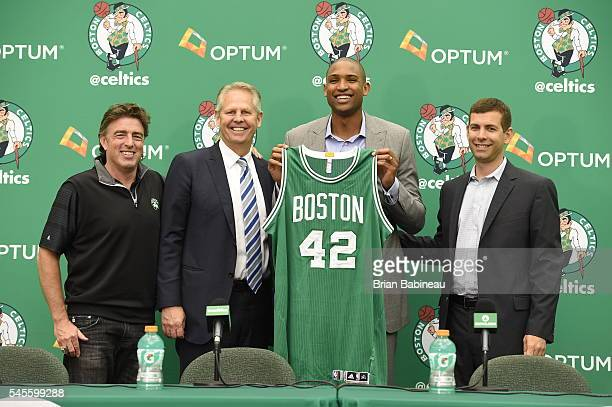 Wycliff Grousbeck Danny Ainge and Brad Stevens welcome Al Horford center as the newest member of the Boston Celtics on July 8 2016 at the Boston...