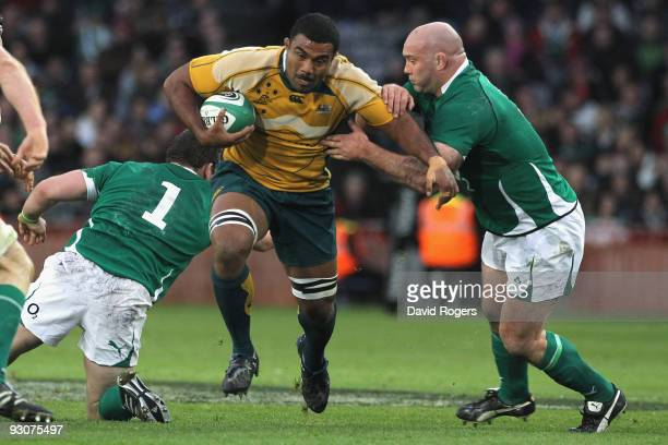 Wycliff Palu of Australia is tackled by John Hayes during the rugby union international match between Ireland and Australia at Croke Park on November...