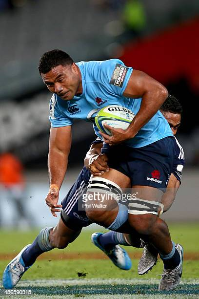 Wycliff Palu of the Waratahs is tackled by Francis Saili of the Blues during the round 11 Super Rugby match between the Blues and the Waratahs at...